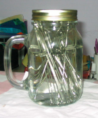 needles in surgical spirit in a jar